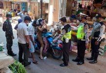 Gugus Tugas Covid-19 di Kotamobagu Ingatkan Pengunjung Pasar Patuhi Protokol Kesehatan