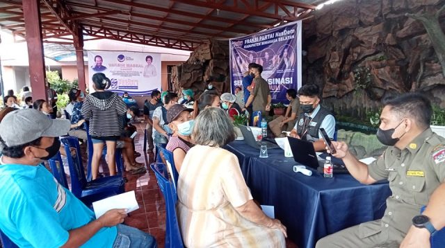 Partai Nasdem Minsel Gelar Vaksinasi Massal di Wilayah Tumpaan